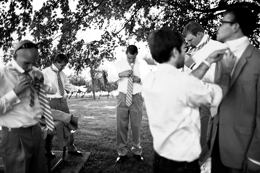 sometimes helping the groom tie their tie is more important than being a photographer